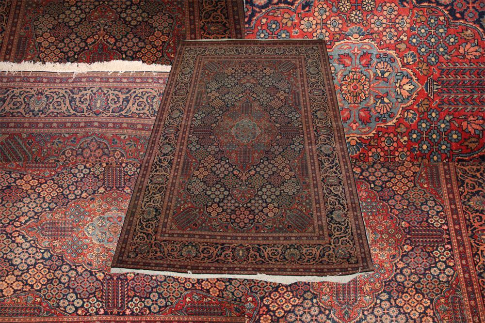 Antique Kashan rug in Josheghan design